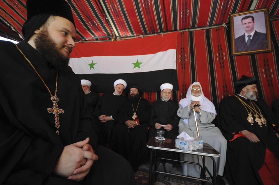 Muslim and Christian clerics gathered inside a tent to express their solidarity with Syria's President Bashar Assad on Tuesday.