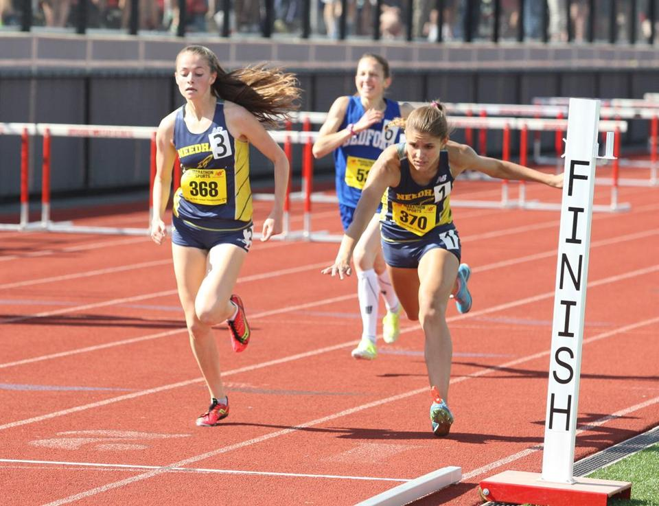 Sarah Armstrong, left, barely edged teammate Kaleigh Hughes in an All-State meet.