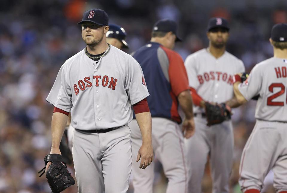 Red Sox starter Jon Lester heads to the dugout after being removed in the fifth inning. He gave up 12 hits and five runs.  (AP Photo/Carlos Osorio)