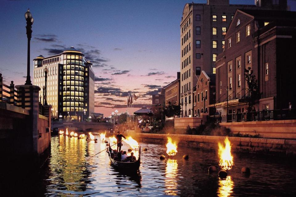 Several fires of the WaterFire installation have been freshly lit at sundown in the Rhode Island School of Design section of Water Place Park in downtown Providence. WaterFire, an award winning art installation by Barnaby Evans, is a series of one hundred bonfires suspended just above the surface of the Providence, Woonasquatucket and Moshassuck Rivers. The artwork runs for two thirds of a mile through the parks of downtown Providence and is li from April to October on selected dates.