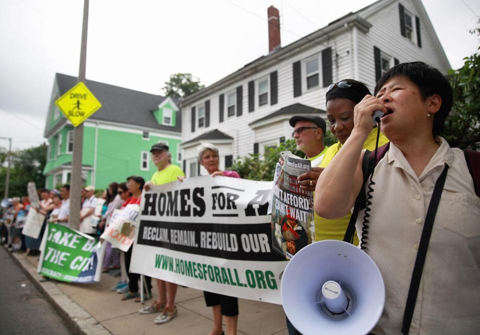 The activists rallied at a Dorchester house thatahomeless family was evicted from.