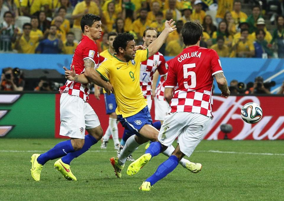 In the most controversial play of the opener, Fred (9) appears to flop, drawing a penalty kick that gave Brazil a 2-1 lead.