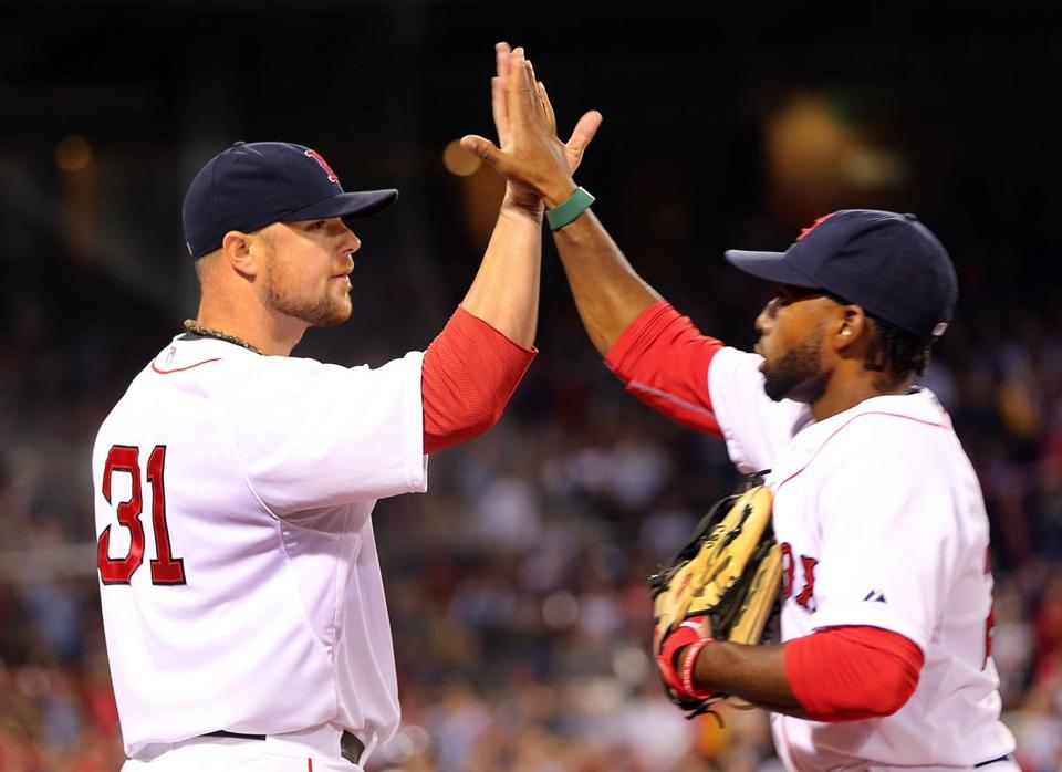 Jon Lester congratulated center fielder Jackie Bradley Jr. after his catch (and double play) in the seventh inning.