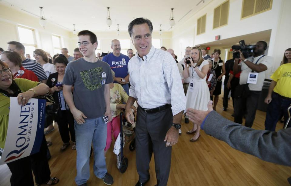 Former Republican presidential nominee Mitt Romney, shown greeting supporters last month at a rally for a Senate candidate in Cedar Rapids, Iowa, was a major force this weekend at a GOP retreat in Utah that he organized.