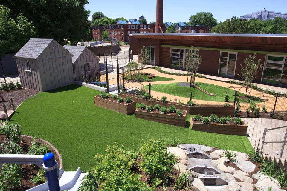 The facility includes 14,000 square feet of outdoor learning and play space.