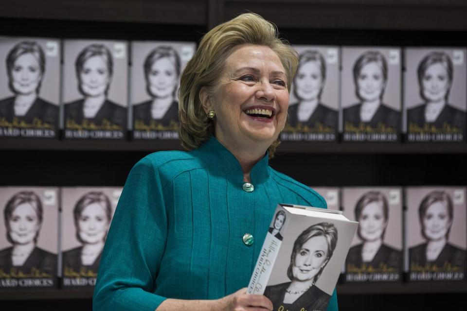 "Hillary Clinton prepares to sign copies of her new memoir, ""Hard Choices,"" in Arlington, Virginia."