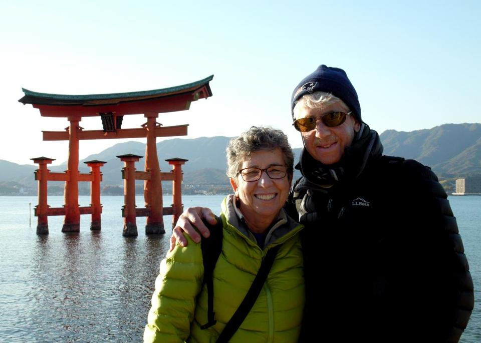 Carol and David Greenfield visited Miyajima, an island off the coast of Hiroshima. The Miyajima Shrine at high tide is seen in the background.