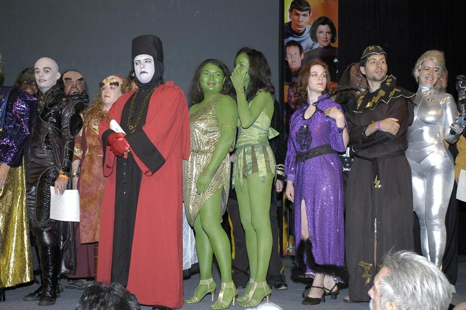"Above: Fans participate in a costume contest during Creation Entertainment's ""Star Trek"" convention in Las Vegas. Below (from left): Creation's CEOs Adam Malin and Gary Berman; Avery Brooks, star of ""Deep Space Nine."""