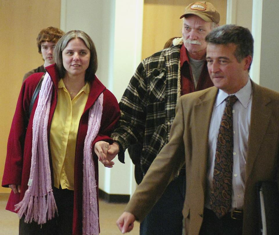 Lynn Dejac Peters and her husband, Chuck, held hands after her murder conviction was overturned by the State Supreme Court in Buffalo. She had served 13 years in prison.