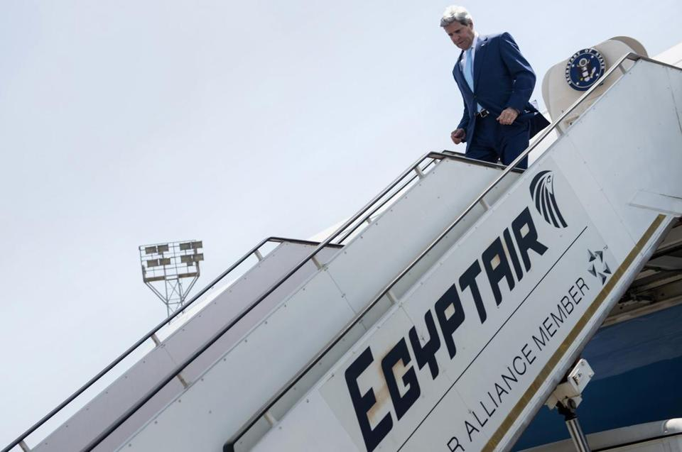 Secretary of State John Kerry disembarks upon his arrival at Cairo International Airport.