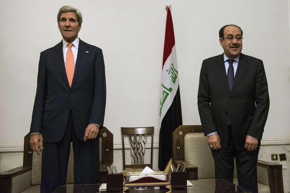 Iraqi Prime Minister Nuri al-Maliki (right) and Secretary of State John Kerry met at the Prime Minister's Office in Baghdad on Monday.