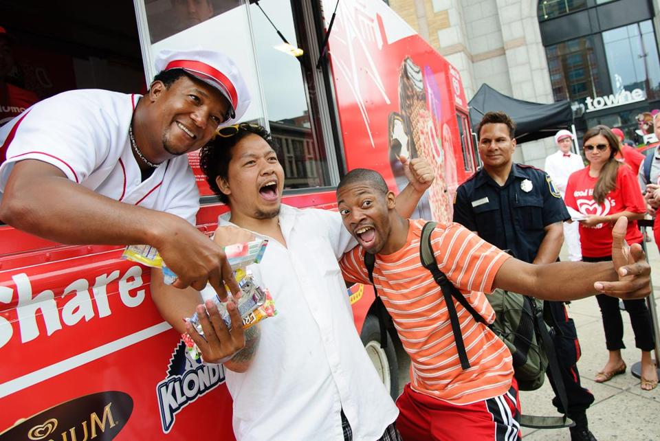 Fans pose for a photo with Pedro Martinez.