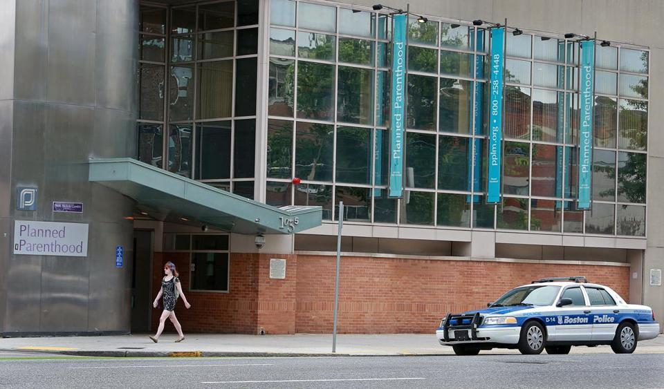 A police officer stood watch outside Planned Parenthood on Commonwealth Avenue in Boston Thursday.