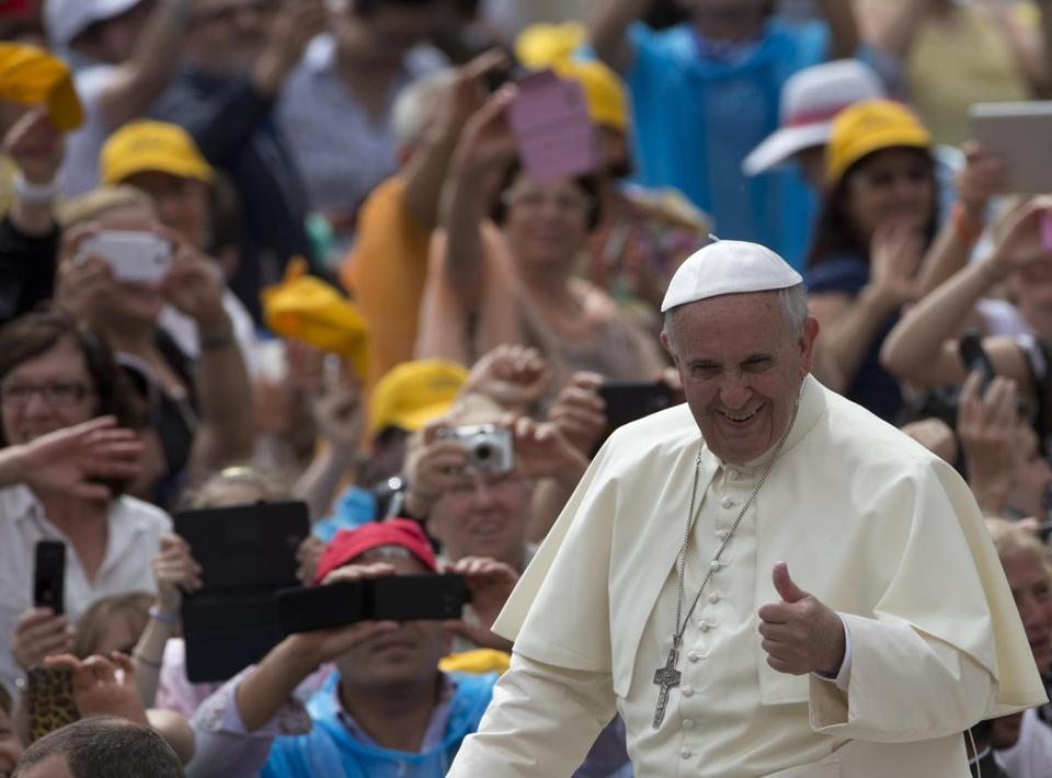 Pope Francis gave a thumbs up as he was driven through the crowd in St. Peter's Square.