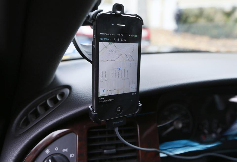 Transportation app Uber is seen on the iPhone of limousine driver Shuki Zanna, 49, in Beverly Hills, California, December 19, 2013. Uber Inc has raised $1.2 billion from mutual funds and other investors in a funding round valuing the fast-growing rides-on-demand service at $18.2 billion, one of the highest valuations ever for a Silicon Valley startup. REUTERS/Lucy Nicholson/Files (UNITED STATES - Tags: BUSINESS TRANSPORT)