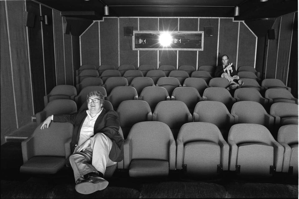 Roger Ebert (front) in the screening room with TV partner Gene Siskel.