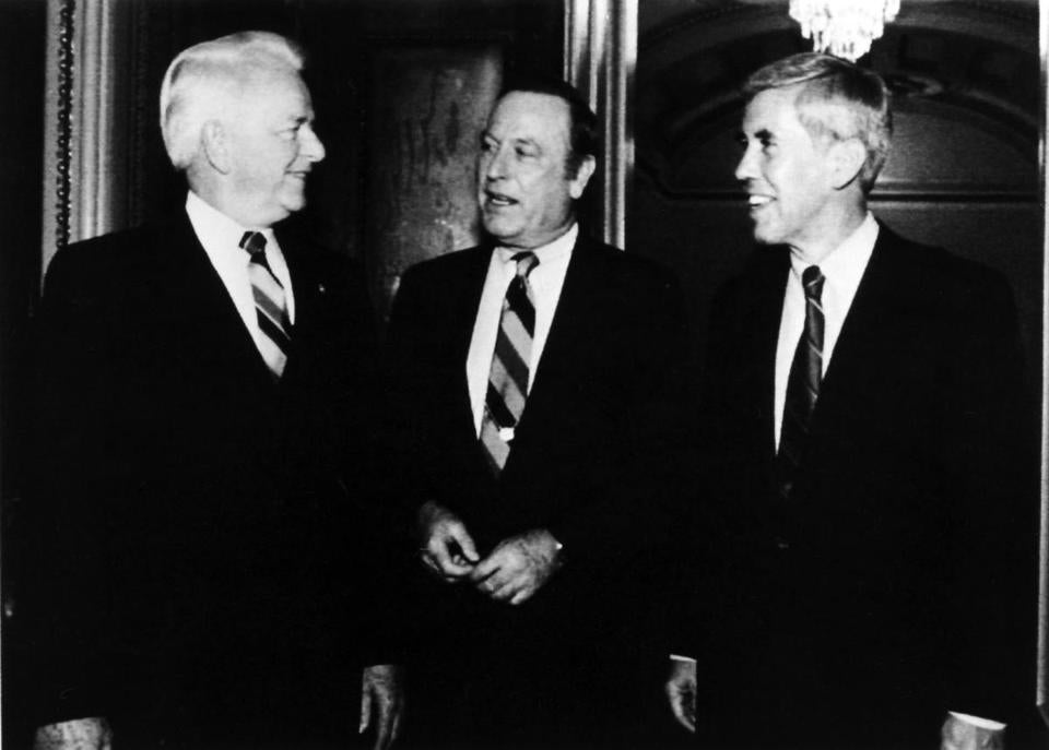 Mr. Dixon conversed with fellow senators Robert Byrd (left) and Richard Lugar (right) on Capitol Hill in 1989.