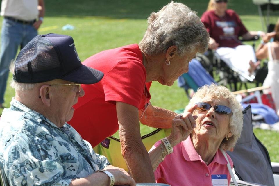 Siblings Bill Brewry (class of 1947), Jean Cameron (class of 1940), and Margaret Jerome (class of 1950) enjoy Rockport's first all-town reunion at Evans Field on July 5.