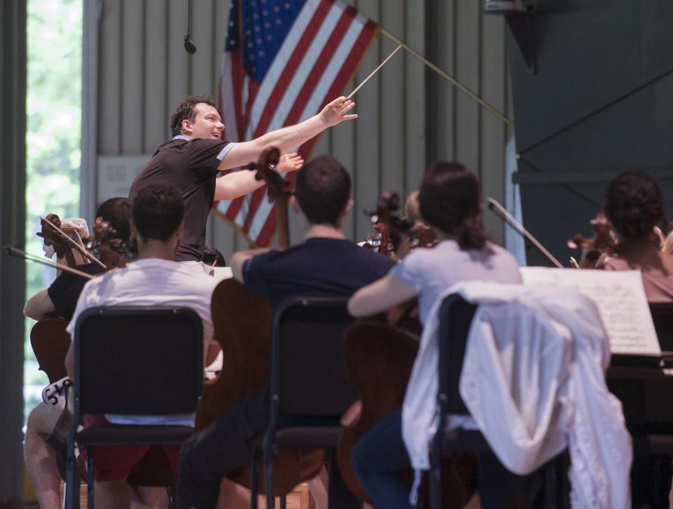 Andris Nelsons in rehearsal conducting the Tanglewood Music Center Orchestra at the Koussevitzky Music Shed at Tanglewood on Tuesday.
