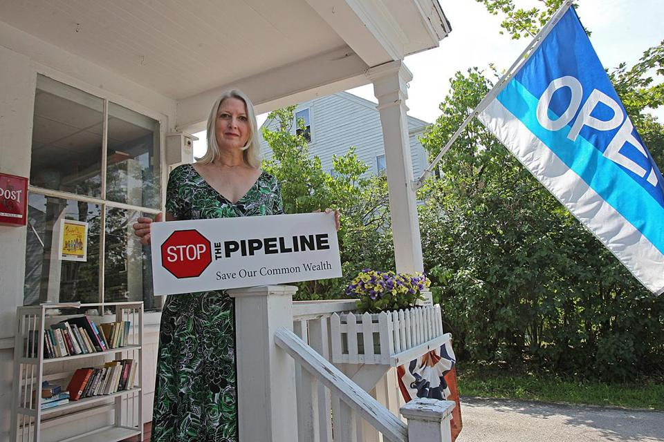 Katharyn Dawson, at her Groton shop, Second Hand Prose, has had a central role in protests against Kinder Morgan's expansion.