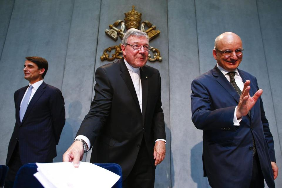 Cardinal George Pell (center) at a news conference at the Vatican on Wednesday.