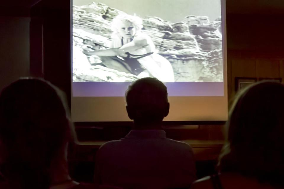"Patrons of Bolton Public Library's Cheesy Movie Festival take in 1953's ""On the Mesa of Lost Women."""