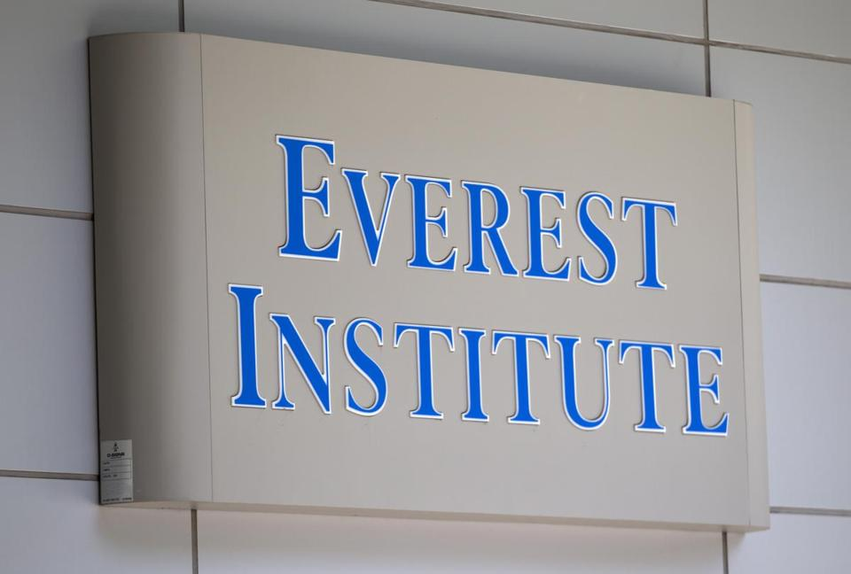 Everest Institute sign is seen in a office building in Silver Spring, Md., Tuesday, July 8, 2014. The dozen campuses that for-profit education company Corinthian Colleges Inc. is closing operate under the Everest name and are scattered in 11 different states, the company announced. (AP Photo/Jose Luis Magana)