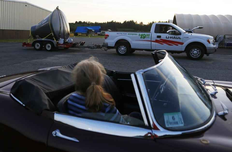 A woman watched as David Ursin drove away with his Gemini capsule at the Minuteman Airfield Wings and Wheels show after trying to sell it in Stow.
