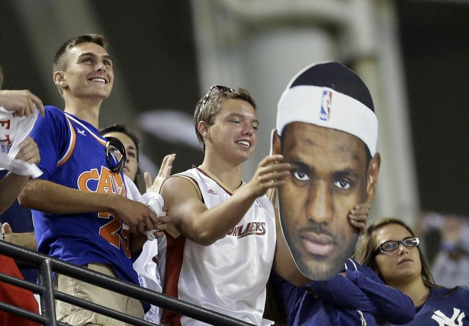 A Cavaliers fan at Thursday's Yankees-Indians game in Cleveland held on to the thought that poster child LeBron James will return home. (AP Photo/Tony Dejak)