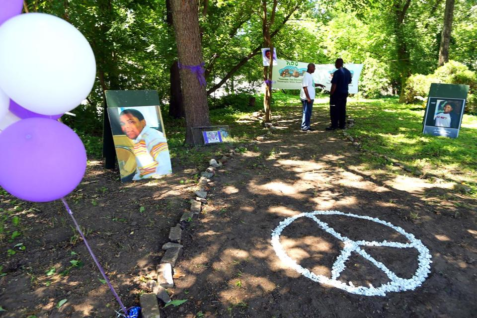 A peace sign leads into the Steven P. Odom Tranquility Garden, which was dedicated Saturday to a 13-year-old boy who was fatally shot in 2007.