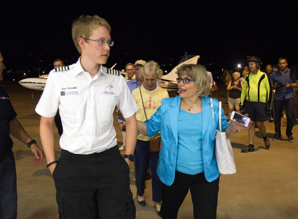 Matt Guthmiller, right, walks with his mother Shirley after arriving in El Cajon, Calif. on Monday at the completion of his solo around-the-world flight.