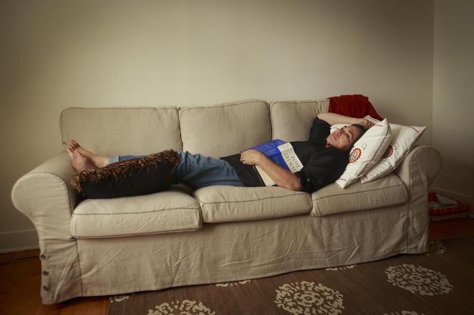 Author Amy Bloom relaxes on her couch in her writing room.