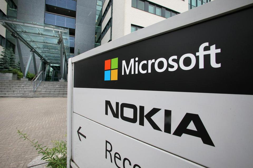 Microsoft Corp said Thursday that it would cut about 14 percent of its workforce as it halves the size of Nokia and trims down other operations.