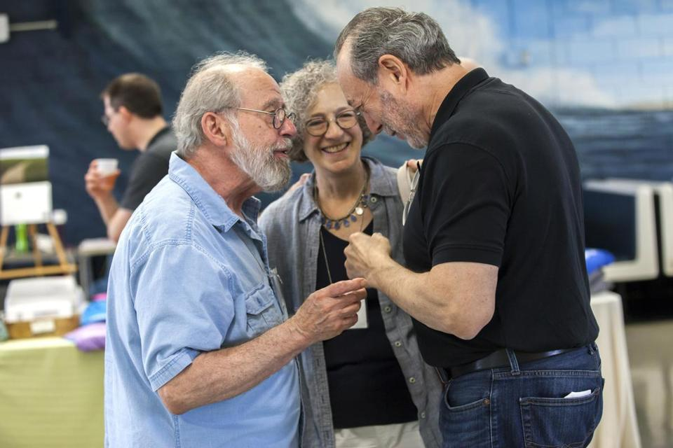"Gil Levin (left), founder and director of the Cape Cod Institute, talks with attendee, Carol Japha (center), and course teacher, Stephen Porges (right), during a coffee break at Nauset High School in Eastham, MA. Porges teaches the course ""Clinical Applications of the Polyvagal Theory"", one of the many week-long courses offered by the Insitute over a 9 week period in the summer. 7/17/14 Julia Cumes for the Boston Globe"