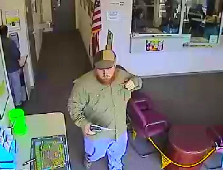 Nathaniel Brudnick is seen on surveillance video cashing in winning tickets at the lottery's Woburn office.