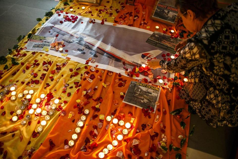 In Kuala Lumpur, a woman lit candles at a memorial for victims of the downed Malaysia Airlines jet.