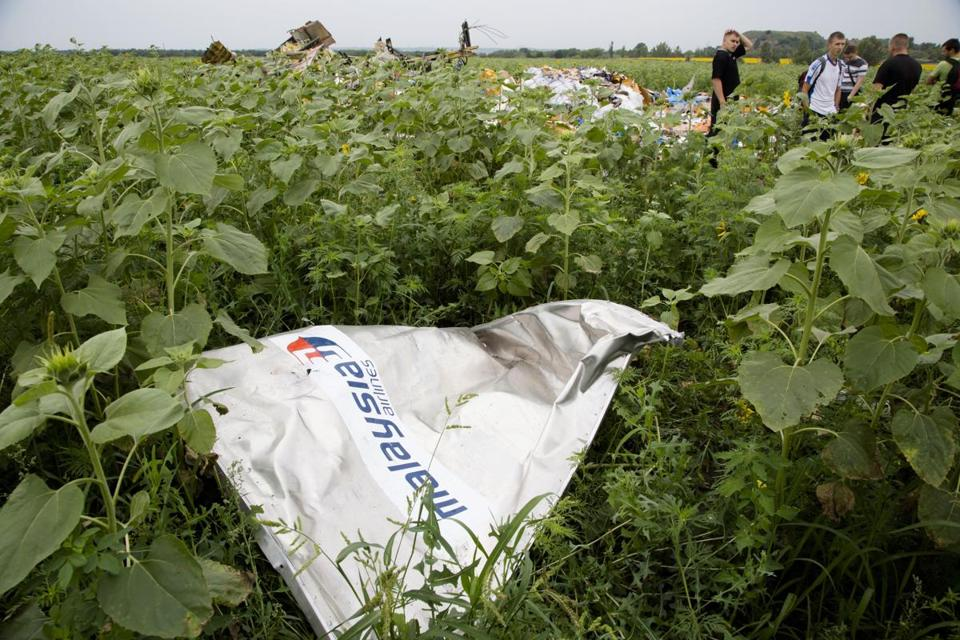 A piece of Malaysia Airlines flight 17 lay in the grass as a group of Ukrainian coal miners searched the site.