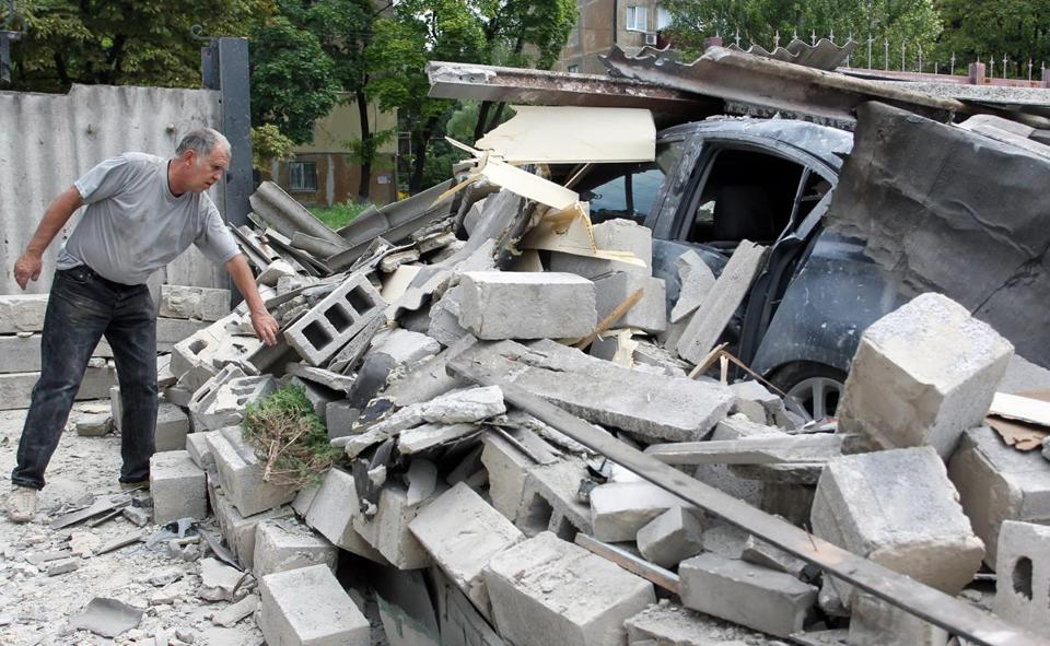 A man looked at rubble Friday on the outskirts of Donetsk, eastern Ukraine, where government officials say their forces have made progress recently.