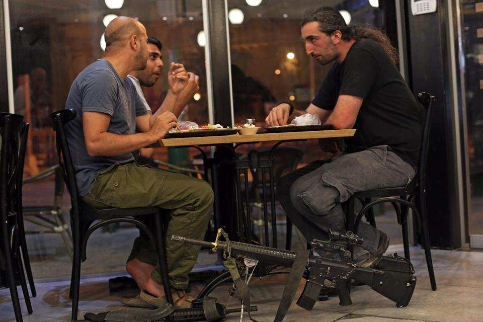 Israeli reserve soldiers enjoyed a meal at a restaurant in the town of Sderot on Saturday, a short time before the end of the 12-hour humanitarian cease-fire with Hamas ended.