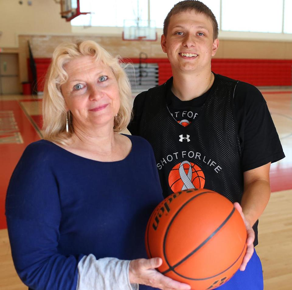 West Roxbury Ma 07/25/2014 Betsy Cullen (cq) left and her son Mike Slonina (cq) right . Her son has raside money with his free throw shooting charity events. Boston Globe Staff/Photographer Jonathan Wiggs Topic: Reporter: