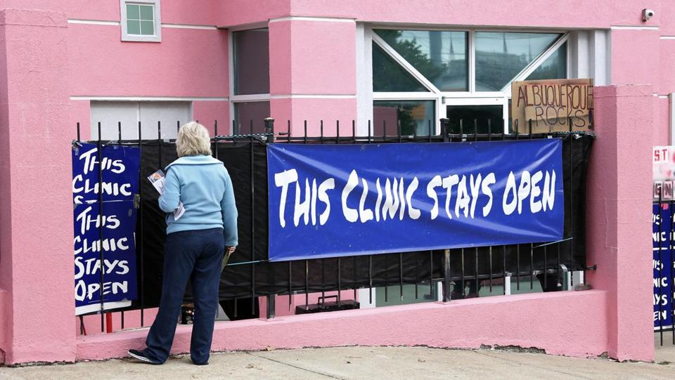 Anti-abortion protester Mary McLaurin called out to a patient hidden on the other side of a sign outside the Jackson Women's Health Organization clinic in Jackson, Miss., the state's only abortion clinic.