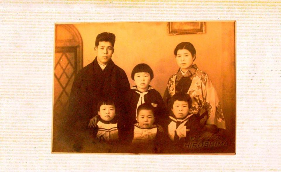 In an undated family photo, Tanemori is the toddler in the middle; his sister Satsuko is on the right.
