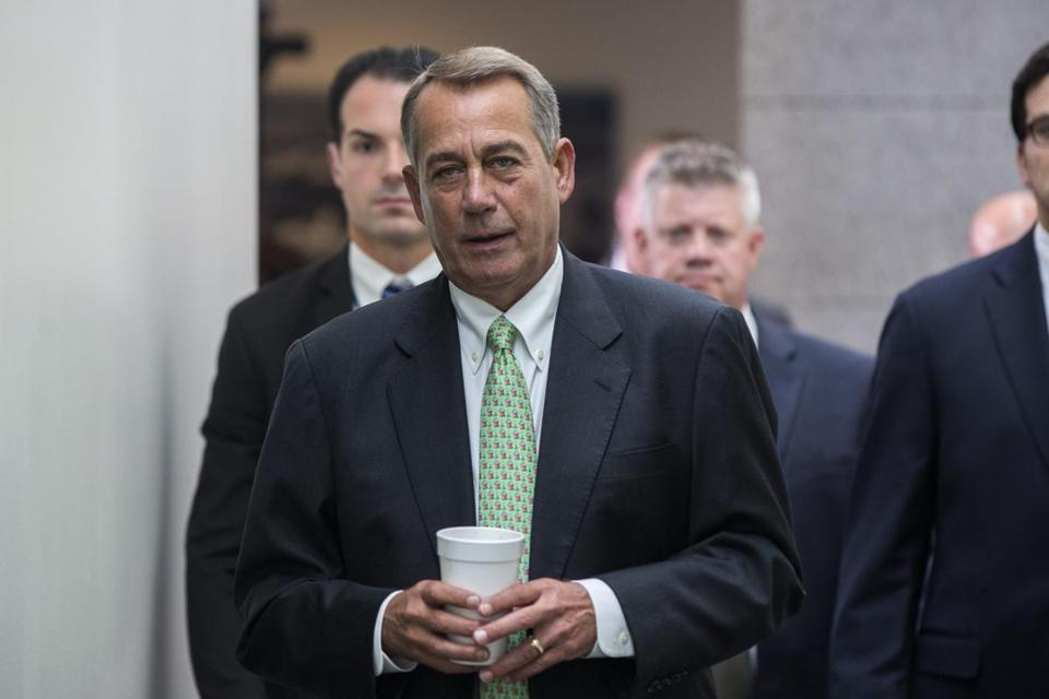 House Speaker John Boehner walked to a Republican conference to negotiate a border bill in the US Capitol on Friday.