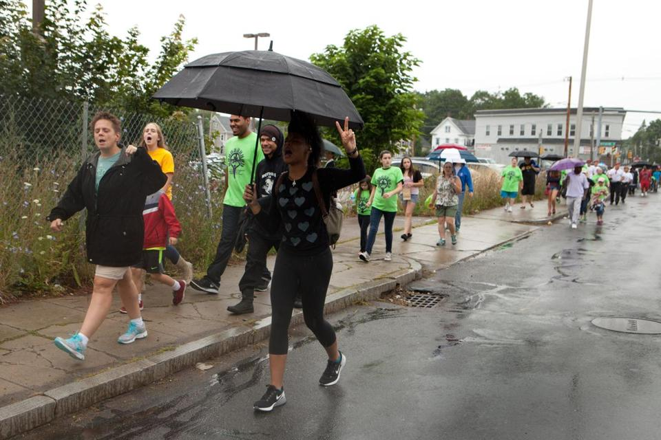 Community members refused to let rain stop them as they marched through Brockton during the festival on Saturday.