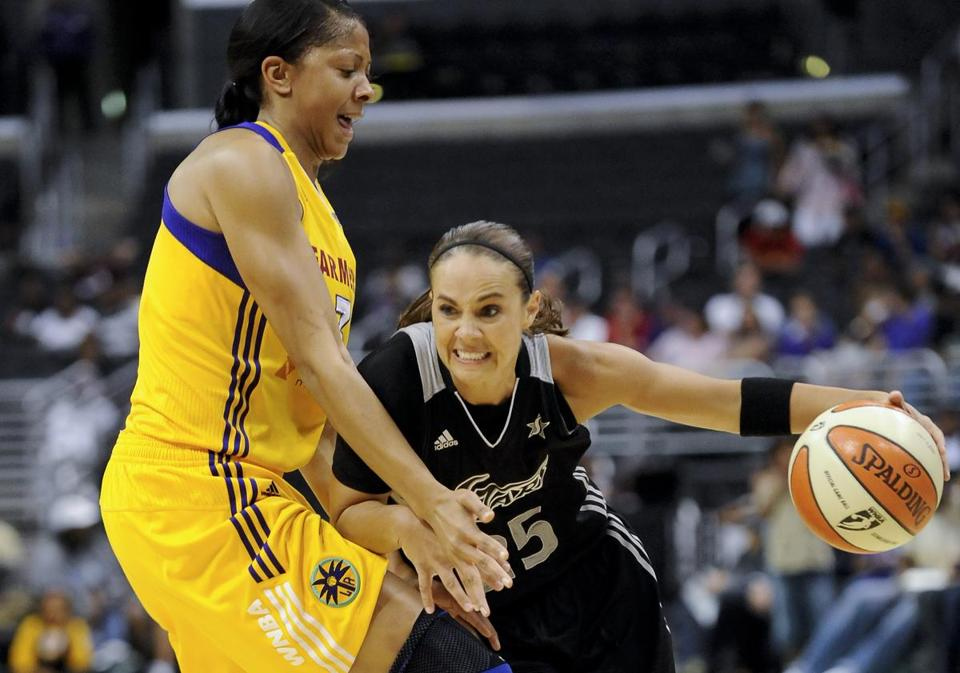 Becky Hammon (right), who is in her 16th and final WNBA season, will retire from playing at the end of this season.