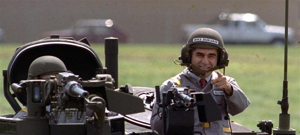 FROM MERLIN ARCHIVE DO NOT RESEND TO LIBRARY Democratic presidential candidate Michael Dukakis gets a free ride in one of General Dynamics' new M1-A-1 battle tanks at its land systems division in Sterling Heights, Mi. Tuesday afternoon September 13, 1988. Dukakis took time out to tell General Dynamics' workers that he's not soft on defense. (AP Photo/Michael Samojeden) prescampaign