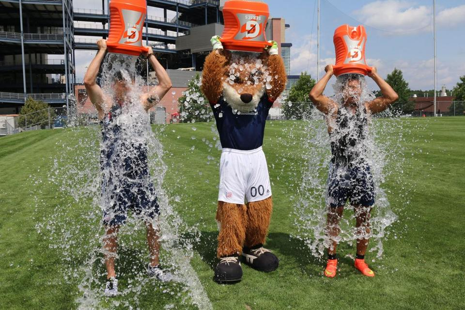 Defender/midfielder Chris Tierney, Revolution mascot Slyde, and forward Charlie Davies did the ice bucket challenge Wednesday.