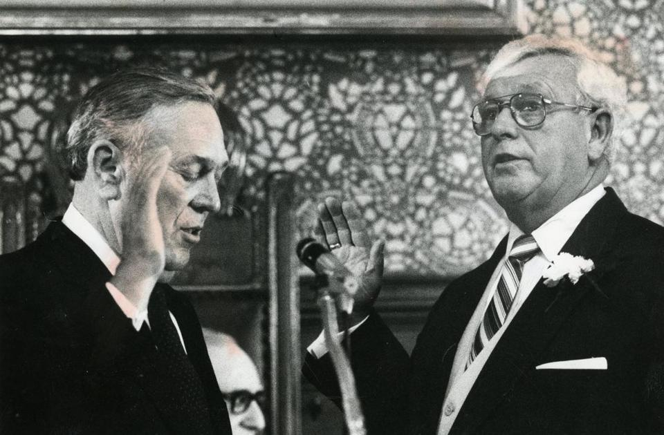 Walter J. Sullivan (right) was sworn in as Cambridge mayor by his brother, Edward J. Sullivan, a former mayor, in 1986.