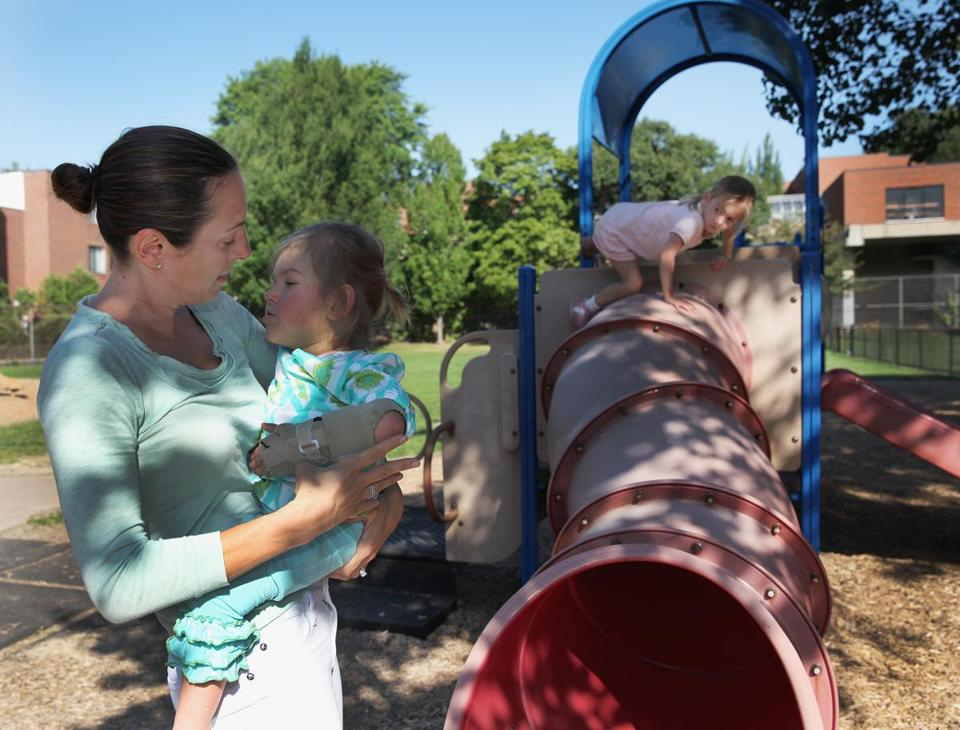 Dawn Oates with daughter Harper, 2, at Brookline Avenue Playground.