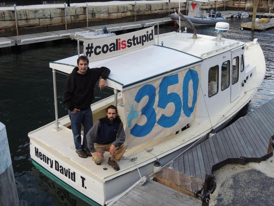 Ken Ward (left) and Jay O'Hara on the boat they used to block the delivery of 40,000 tons of coal to a power plant in Somerset.